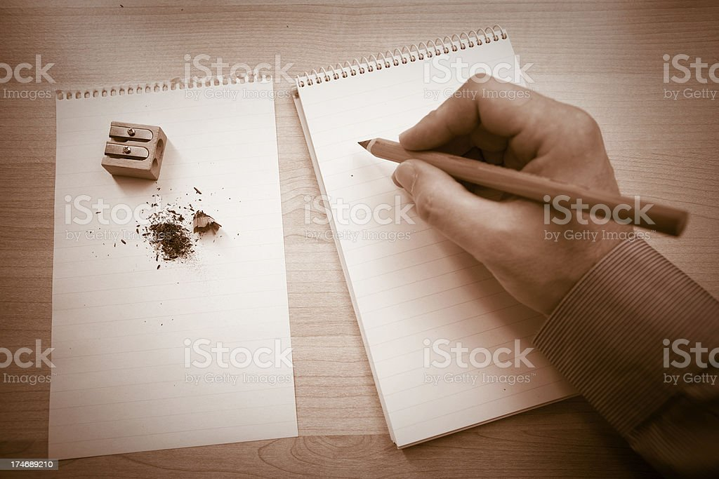 Hand writing a note royalty-free stock photo