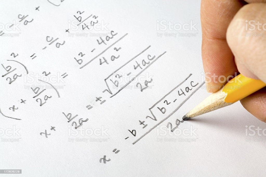 Hand writing algebra equations royalty-free stock photo