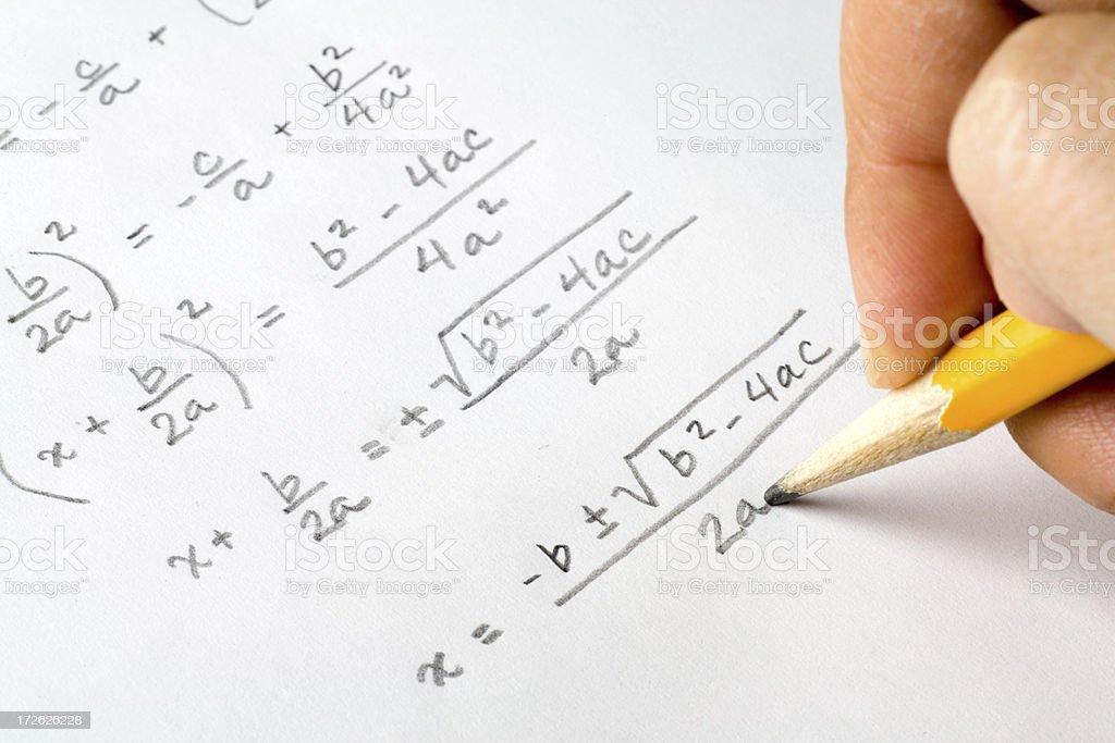 Hand writing algebra equations stock photo