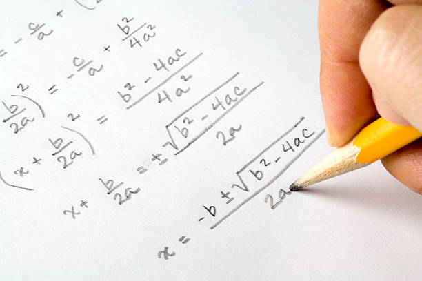 Hand writing algebra equations stock photo