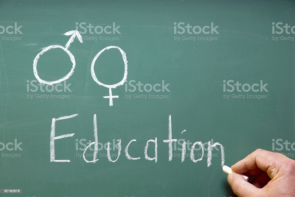 Hand writing chalk on blackboard titled about Sex Education stock photo