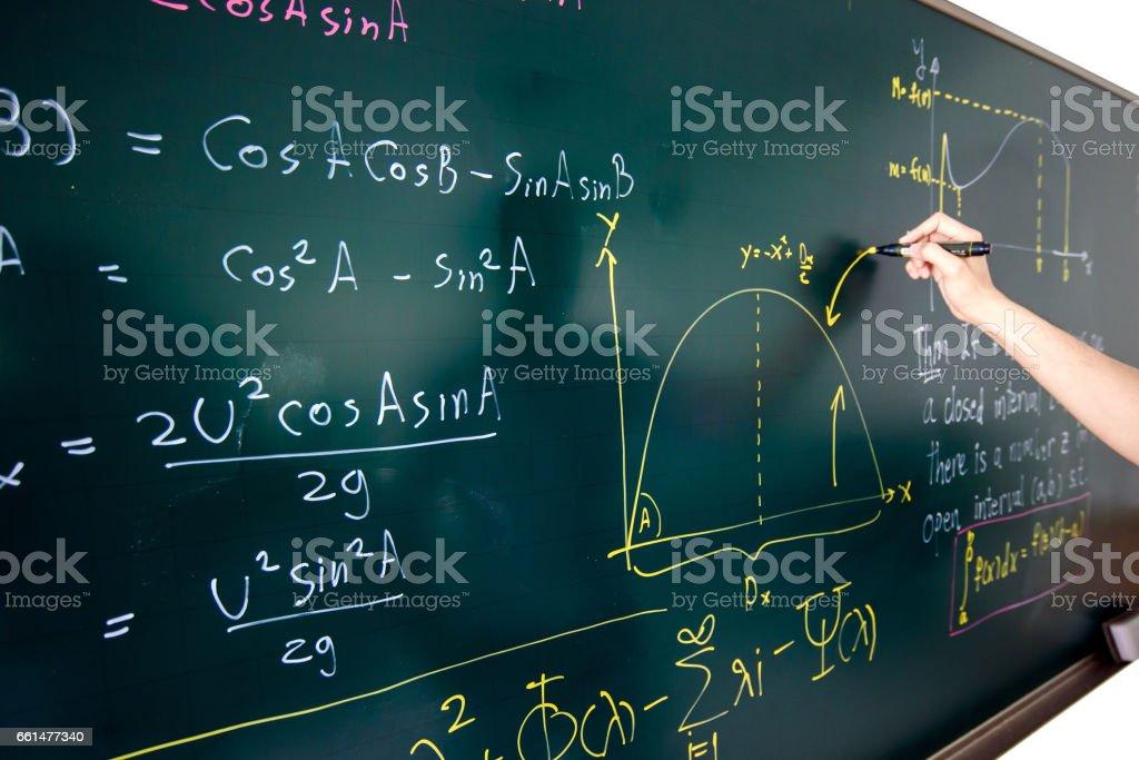 hand writing complicated math equation stock photo