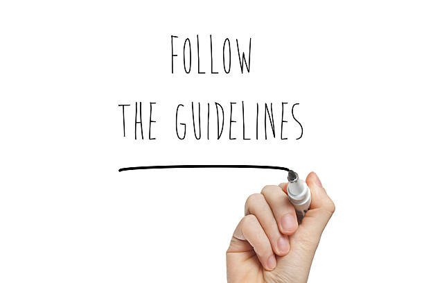 Hand writing follow the guidelines stock photo