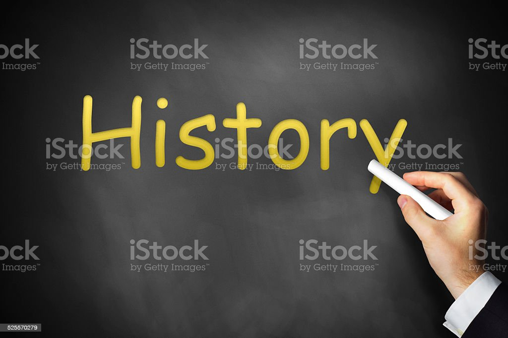 hand writing history on black chalkboard stock photo