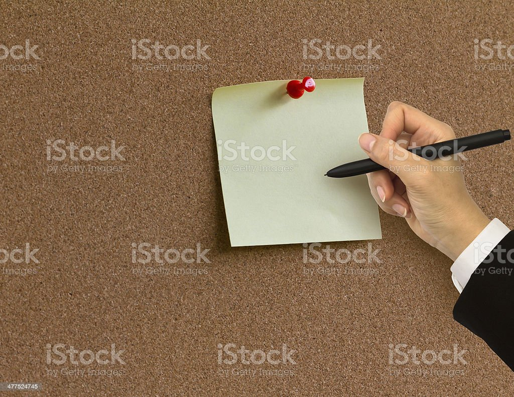 Hand writing in paper note on cork board background royalty-free stock photo