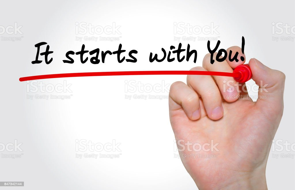 Hand writing inscription It starts with You with marker, concept stock photo