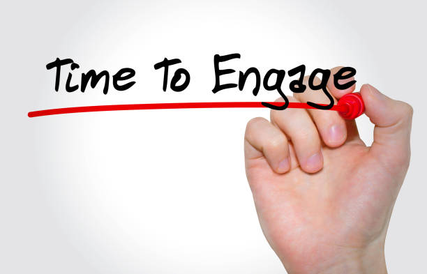 hand writing inscription time to engage with marker, concept - employee engagement stock photos and pictures