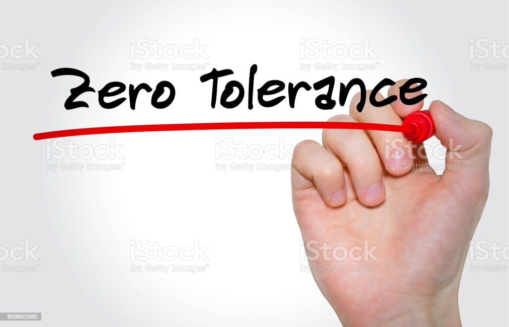 Hand writing inscription Zero Tolerance with marker, concept stock photo