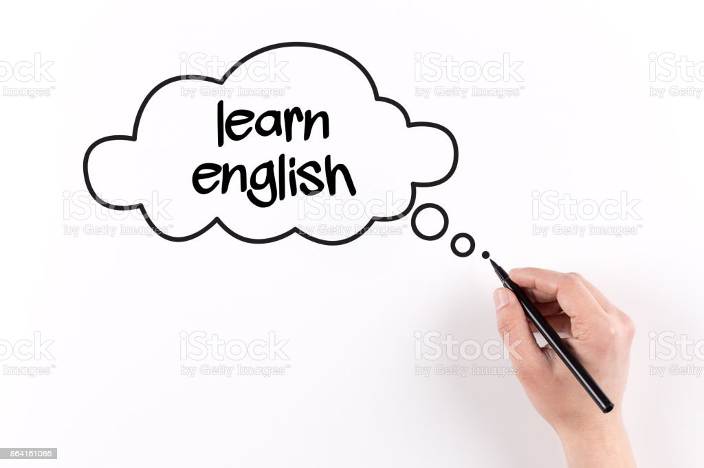 Hand writing LEARN ENGLISH on white paper, View from above royalty-free stock photo