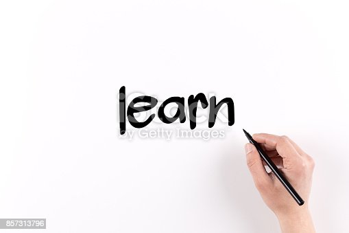 850892616 istock photo Hand writing Learn on white paper, View from above 857313796