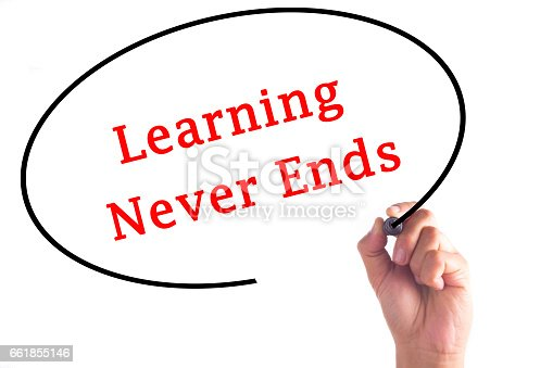 istock Hand writing Learning Never Ends on transparent board 661855146