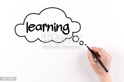 850892616 istock photo Hand writing Learning on white paper, View from above 855758922