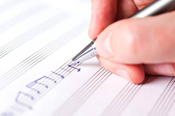 Handschreiben von Musiknotizen – Foto