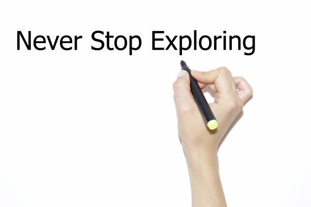 Hand writing never stop exploring with marker isolated on white. Hand writing never stop exploring with marker isolated on white. descry stock pictures, royalty-free photos & images