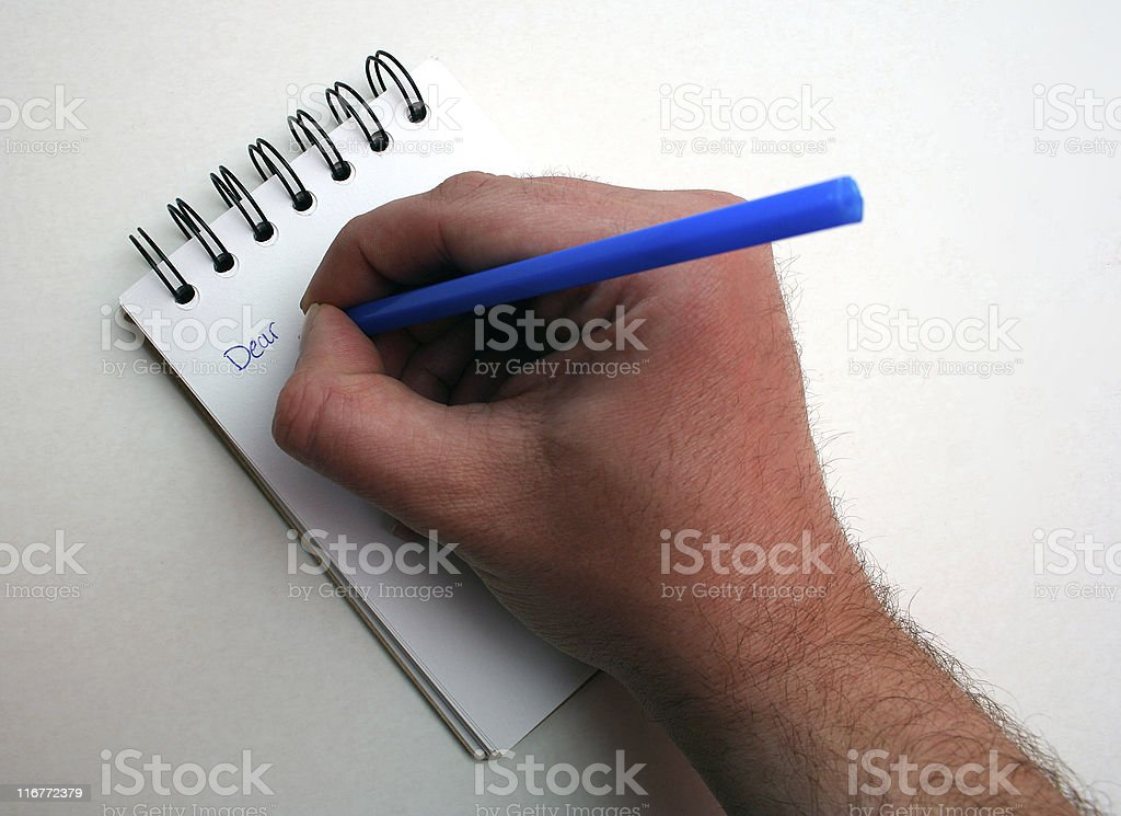 Hand writing note in notepad royalty-free stock photo
