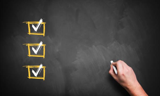 hand writing on a blackboard with checked boxes - feedback icon imagens e fotografias de stock