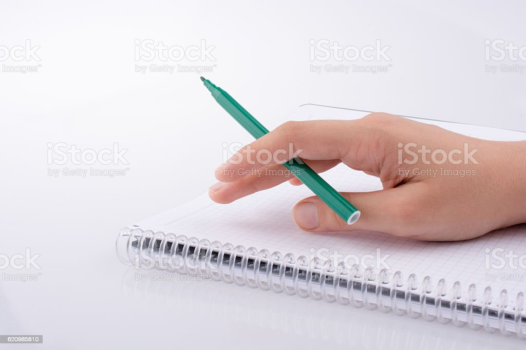 Hand writing on a Notebook foto royalty-free