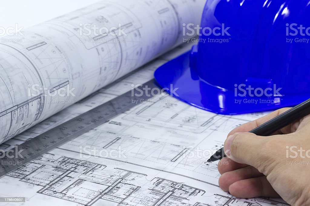 hand writing on blue print with hard hat and ruler stock photo