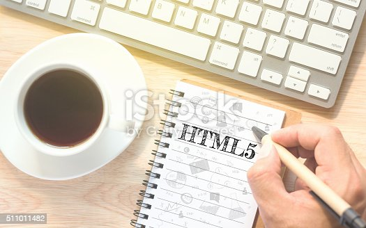 istock Hand writing on book message HTML5. 511011482