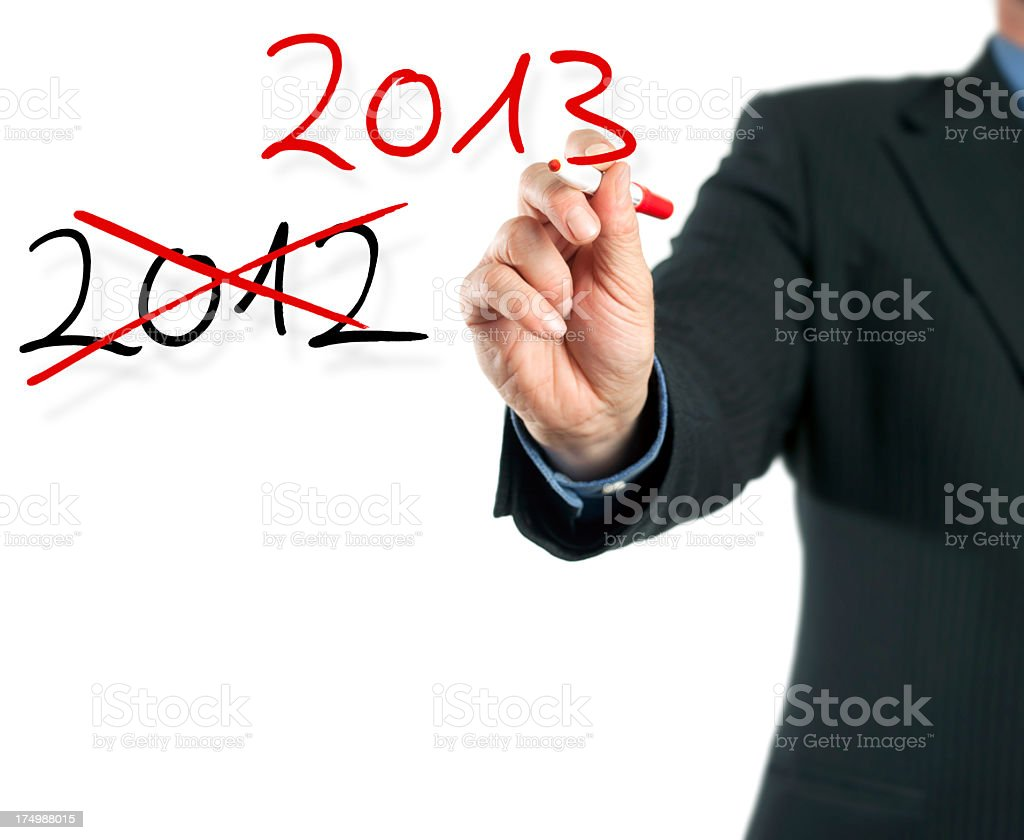 Hand writing on imaginary screen - Turn of the Year royalty-free stock photo