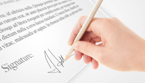 Hand writing personal signature on a paper form Hand writing personal signature on a legal paper signature collection stock pictures, royalty-free photos & images