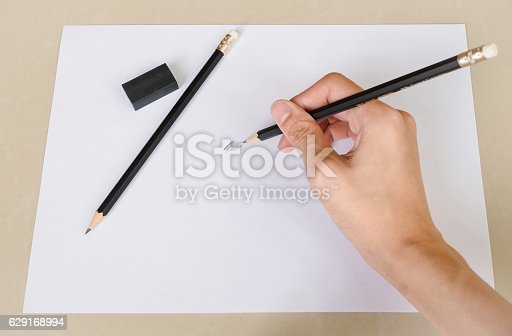 istock Hand writing something by Pencil Eraser and Erase rubber 629168994