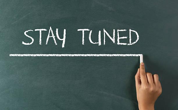 "hand writing ""stay tuned"" on blackboard - stay tuned bildbanksfoton och bilder"