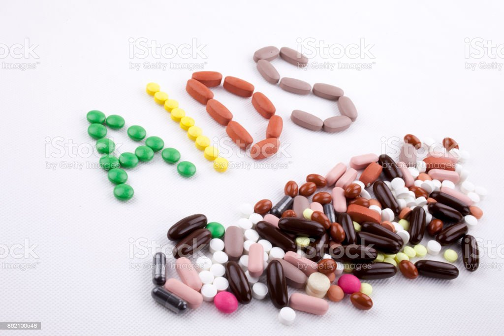 Hand writing text caption inspiration Medical care concept written with pills drugs capsule word Aids On white isolated background with copy space stock photo