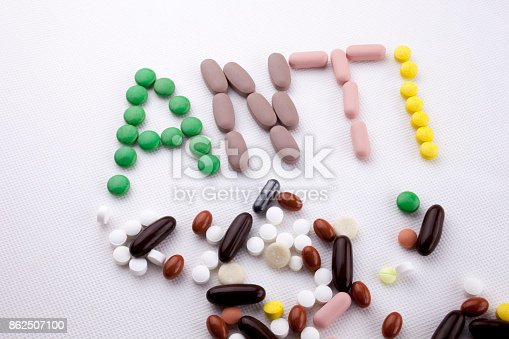 istock Hand writing text caption inspiration Medical care concept written with pills drugs capsule word ANTI forever young age feel anti aging On white isolated background with copy space 862507100