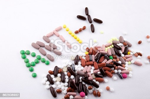 istock Hand writing text caption inspiration Medical care concept written with pills drugs capsule word ANTI X forever young age feel anti aging On white isolated background with copy space 862508932