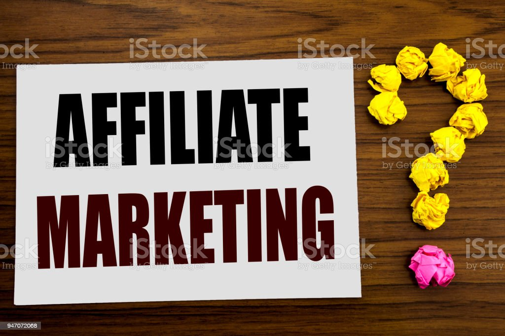 Hand writing text caption inspiration showing Affiliate Marketing. Business concept for Internet Online written on white note paper on the wooden background with question mark on the end. stock photo