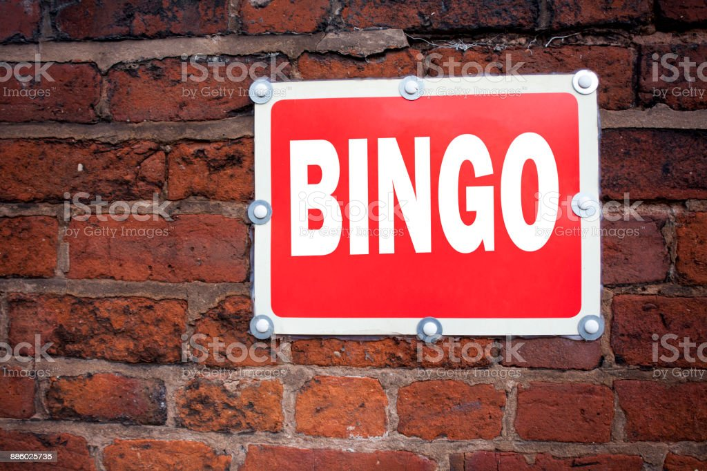 Hand writing text caption inspiration showing Bingo concept meaning Lettering Gambling to Win Price Success written on old announcement road sign with background and copy space stock photo