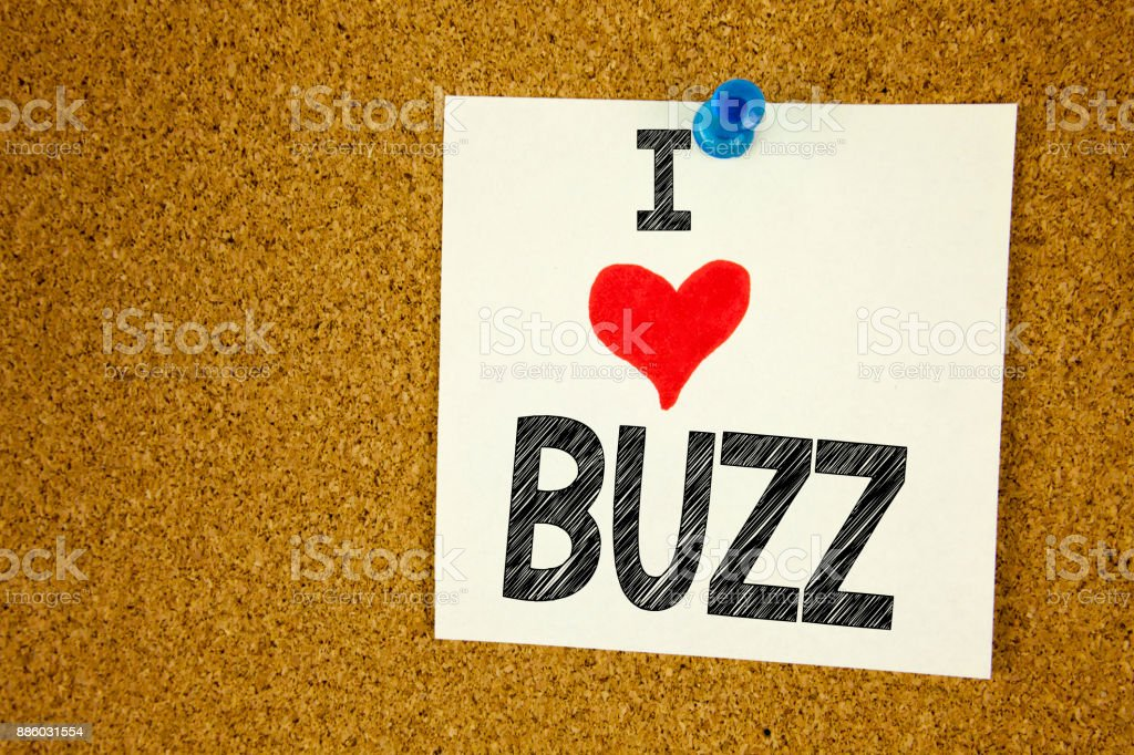 Hand writing text caption inspiration showing Buzz concept meaning Buzz Word llustration and Love written on sticky note, reminder isolated background with copy space stock photo