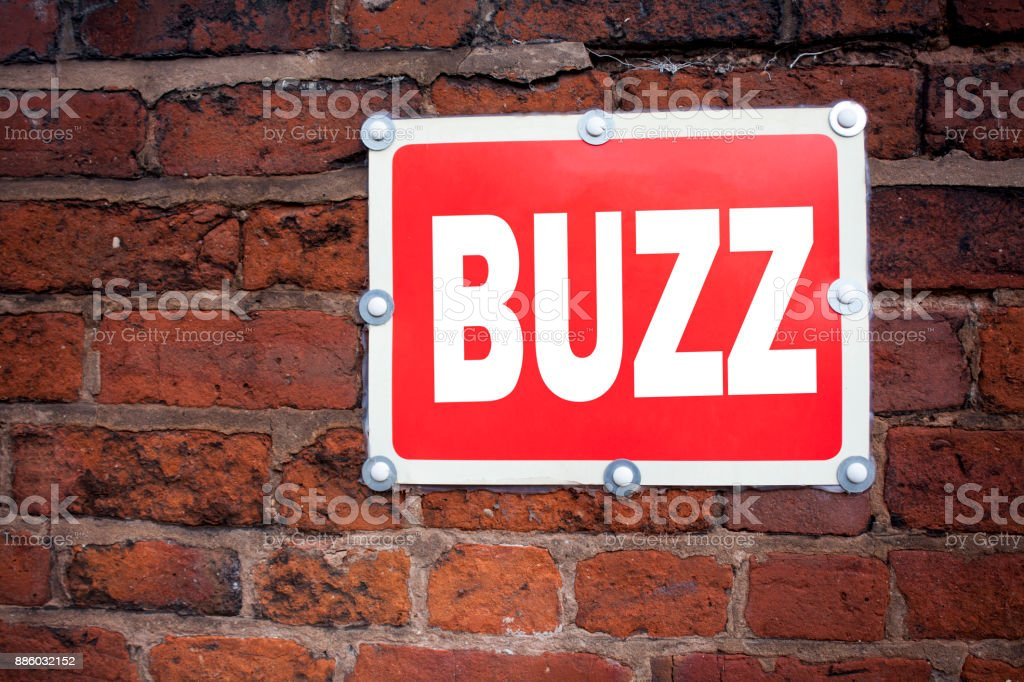Hand writing text caption inspiration showing Buzz concept meaning Buzz Word llustration written on old announcement road sign with background and copy space stock photo