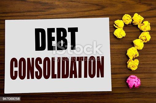 Hand writing text caption inspiration showing Debt Consolidation. Business concept for Money Loan Credit written on white paper on the wooden background with question mark on the end.