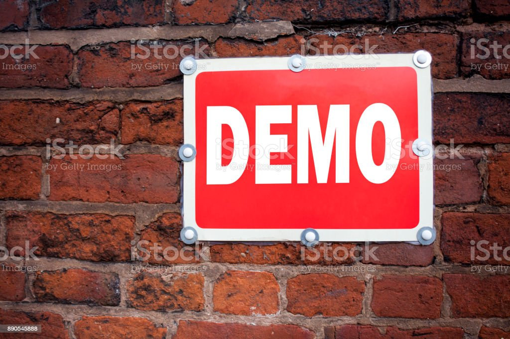 Hand writing text caption inspiration showing Demo concept meaning Software Demonstration written on old announcement road sign with background and copy space stock photo