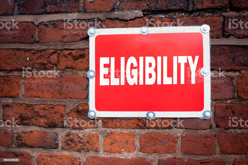 Hand writing text caption inspiration showing Eligibility concept meaning Suitable Eligible Eligibility written on old announcement road sign with background and copy space stock photo