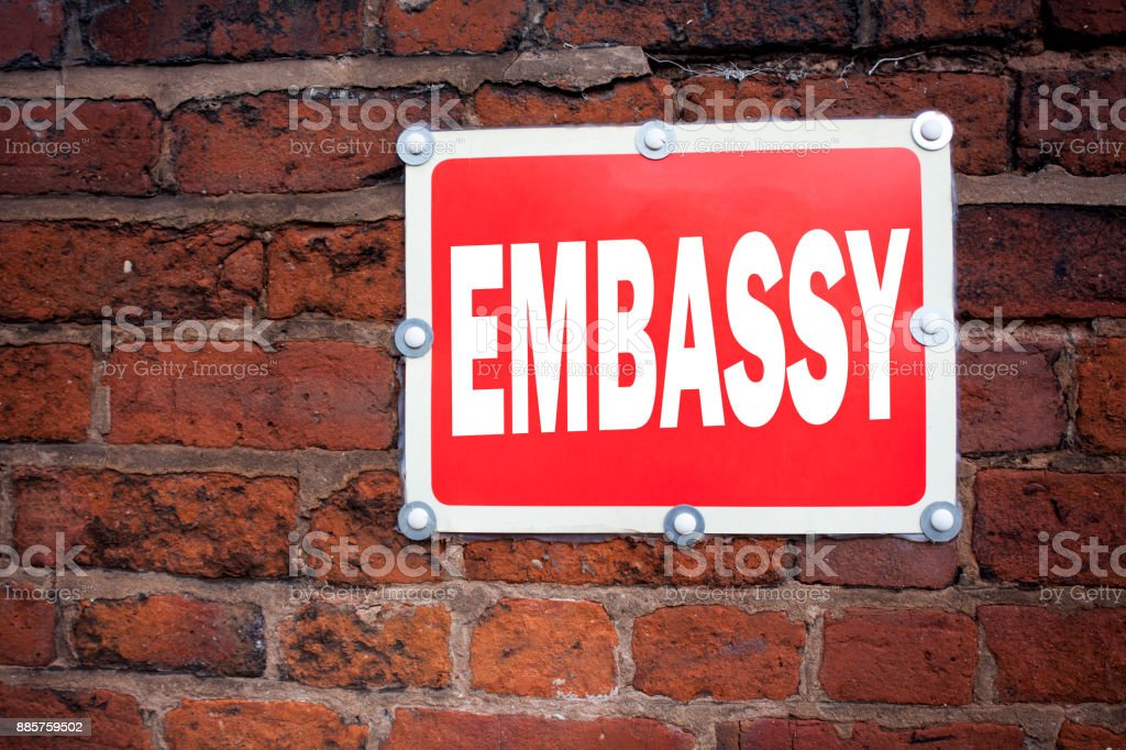 Hand writing text caption inspiration showing Embassy concept meaning Tourist Visa Application written on old announcement road sign with background and copy space stock photo
