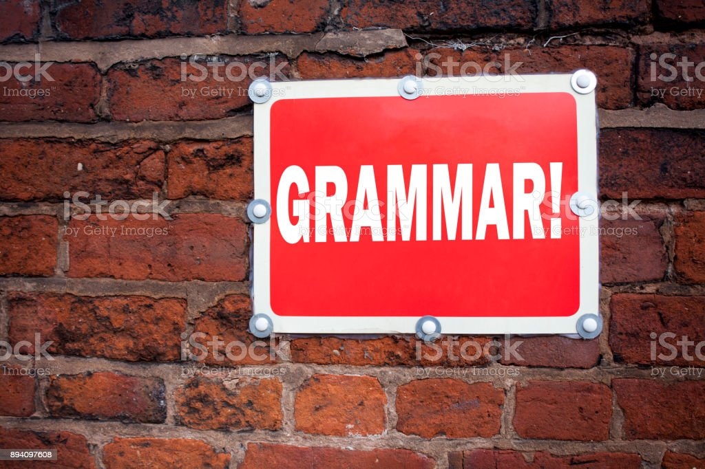 Hand writing text caption inspiration showing Grammar concept meaning  The Basic Rules of Syntax Grammatical Language written on old announcement road sign with background and copy space stock photo