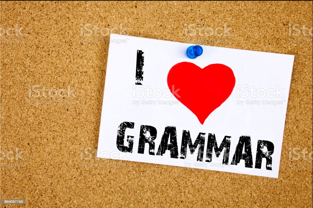 Hand writing text caption inspiration showing I Love Grammar concept meaning  The Basic Rules of Syntax Grammatical Language Loving written on sticky note, reminder isolated background with copy space stock photo