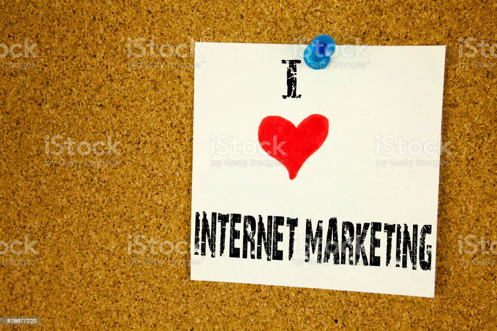 Hand writing text caption inspiration showing I Love Internet Marketing concept meaning Technology Strategy Design Loving written on sticky note, reminder isolated background with copy space stock photo