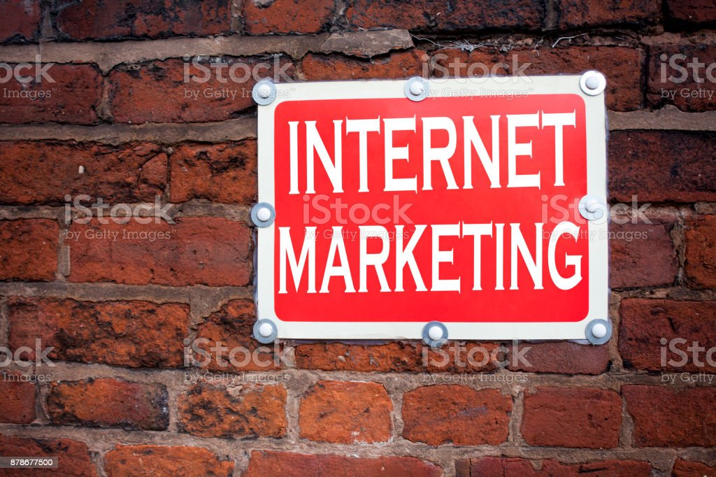 Hand writing text caption inspiration showing Internet Marketing concept meaning Technology Strategy Design written on old announcement road sign with background and copy space stock photo