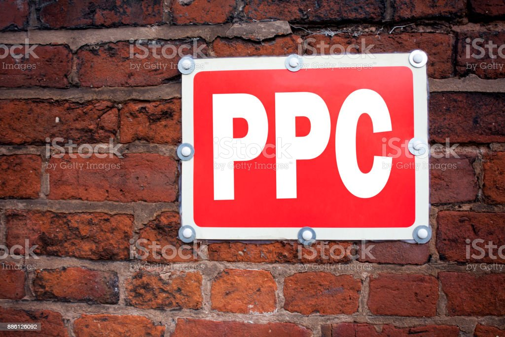 Hand writing text caption inspiration showing PPC - Pay per Click concept meaning Internet SEO Money written on old announcement road sign with background and copy space stock photo