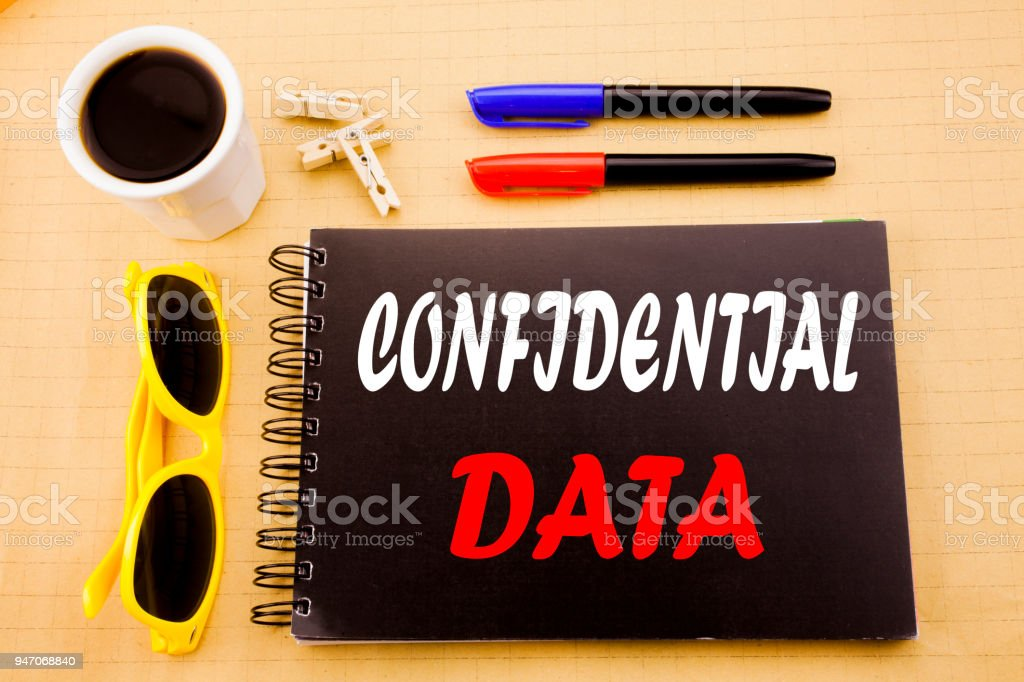 Hand writing text caption showing Confidential Data. Business concept for Secret Protection written on sticky note with copy space on old wood wooden background with sunglasses stock photo