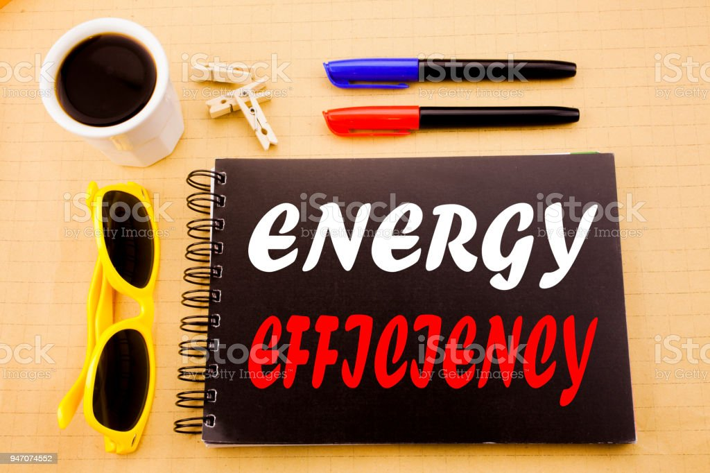 Hand writing text caption showing Energy Efficiency. Business concept for Electricity Ecology written on sticky note with copy space on old wood wooden background with sunglasses stock photo