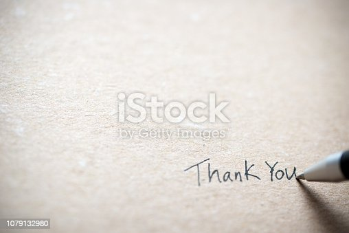 istock Hand writing thank you note 1079132980