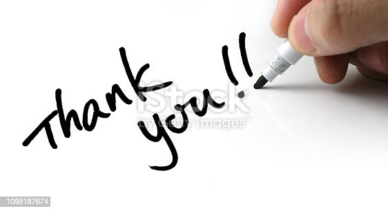 1050881964 istock photo Hand Writing Thank You Note with Felt Tip Pen 1095187674