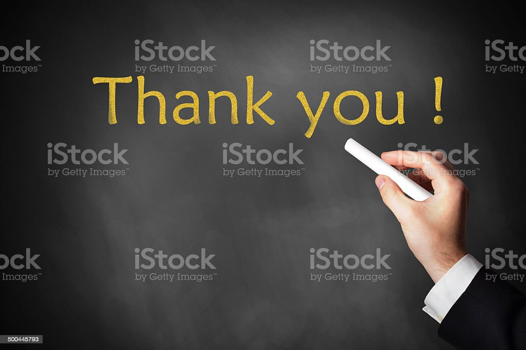 hand writing thank you on chalkboard stock photo
