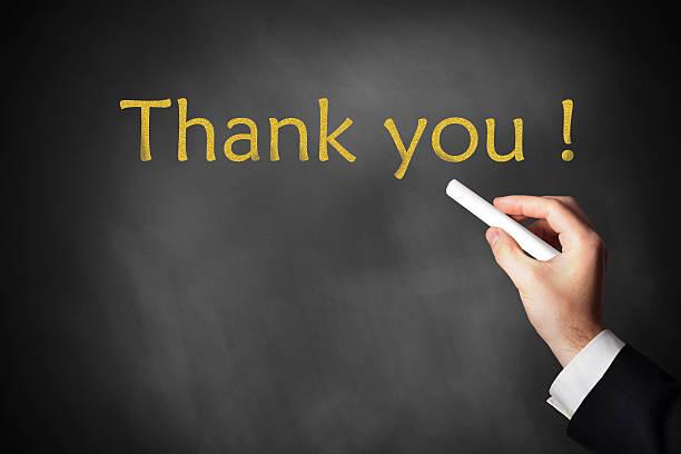 hand writing thank you on chalkboard stock photo