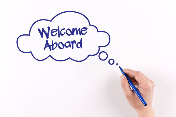 Hand writing Welcome Aboard on white paper, View from above Hand writing Welcome Aboard on white paper, View from above aboard stock pictures, royalty-free photos & images